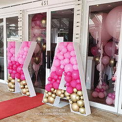 Big balloons, mosaic letters, red carpet