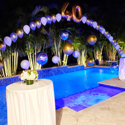 Balloon arch over a swimming pool!