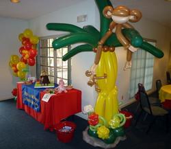 Monkey on the balloon palm tree