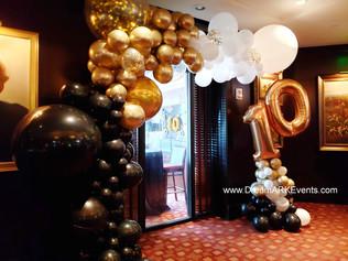 Restaurant anniversary gold and black