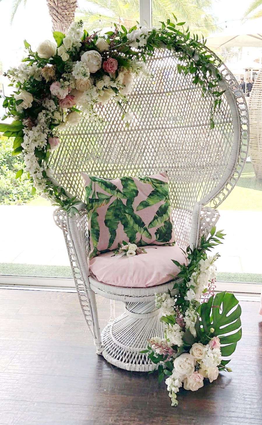 Wicker Chair Decorated With Fresh Flowers