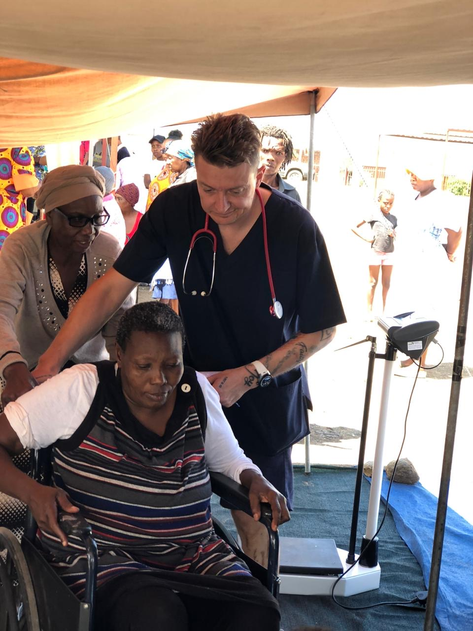 Dr Heyneke with a Patient