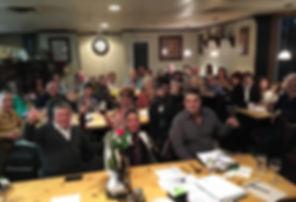 Members Toasting at Meeting