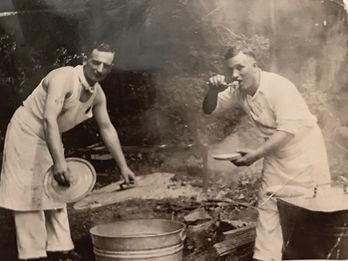 John (left) and man cooking at Bellosqua