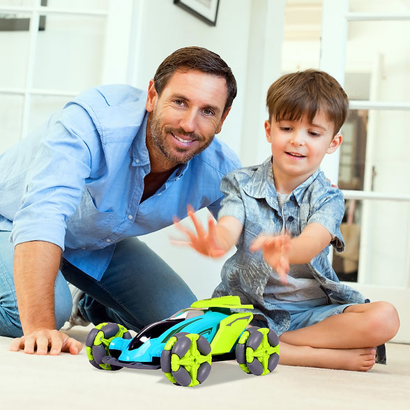 Father-with-little-boy-playing-with-toy-