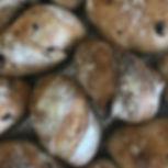 Mini kalamata olive sourdough loaves at