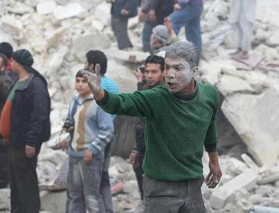 syria-trauma-man-amidst-destruction-homsuptodatenews-3-2-2013