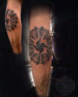 hindu swastika tattoo, good luck tattoo, elbow tattoo, mandala tattoo, men with tattoos, dotwork tattoos, dotwork in london, dotwork tattoo artist, geometric tattoo, geometric tattoo artist in london, deity tattoo, divine canvas tattoo artist