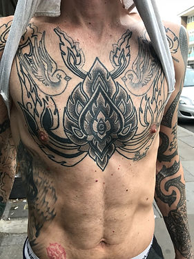 Dotwork tattoo, chest tattoo, dotwork artist in london, deity tattoo, divine canvas, thai tattoo, tattooed guys,