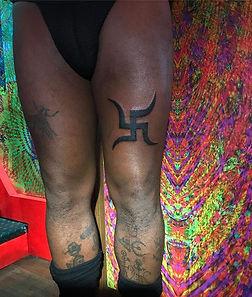 blackwork leg tattoo, jain swasika, swastika tattoo