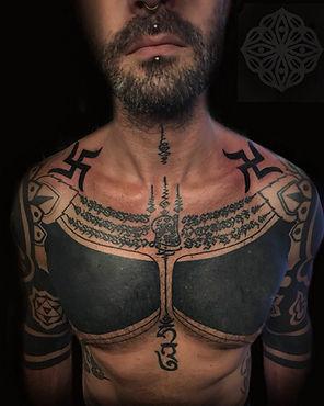 Blackwork tattoos, jain swastikas, hot tattooed men, deity tattoo, geometric tattoos, dotwork tattoos, best dotwork tattoo artist london, best geometric tattoo artist london, london tattoo studios, divine canvas, hand poke tattoo artist, londons best tattoo studio