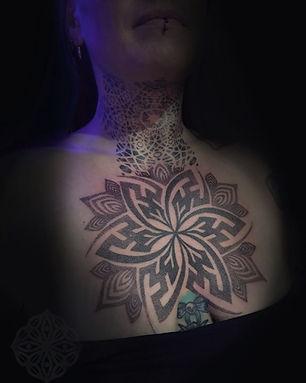 chest tattoo, dotwork tattoo, tattooed girl, deity tattoo, mandala tattoo, dotwork tattoo artist, brighton tattoo, london tattooist, geometric tattoo artist in london, divine canvas, dotwork in london, best dotwork in london, best tattoo studios in london