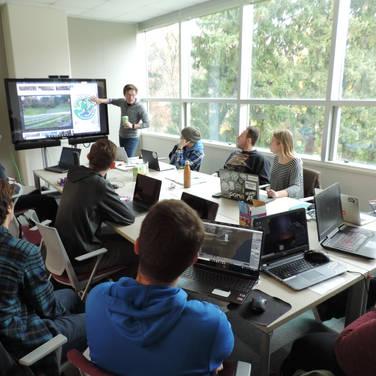 Jacob Bruner_SGP President_Leading a rendering team meeting