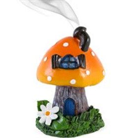 An orange toadstool house design incense cone burner.