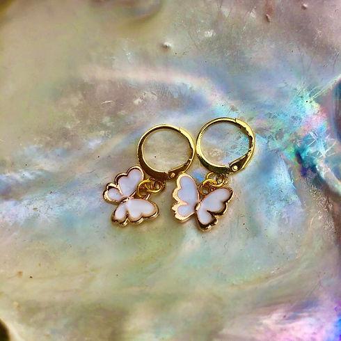 Ditsy earrings on shell.jpg