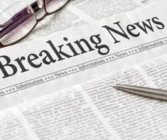 A newspaper with the headline Breaking N