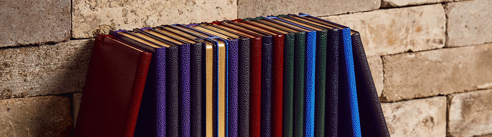 Rollo London Stationery, luxury notebooks bound with faux leather and decorated with a gold charm.  The perfect gift or Christmas present
