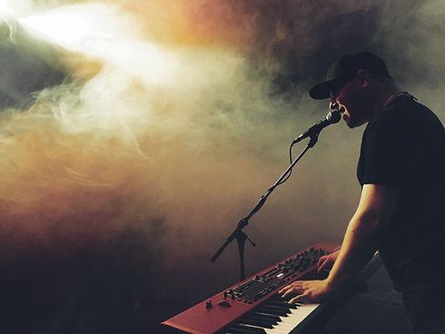 Sings and plays organ