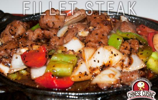 Fillet steak with black pepper sauce on hot plate
