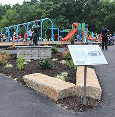Arlington Park Statue and Play.jpg