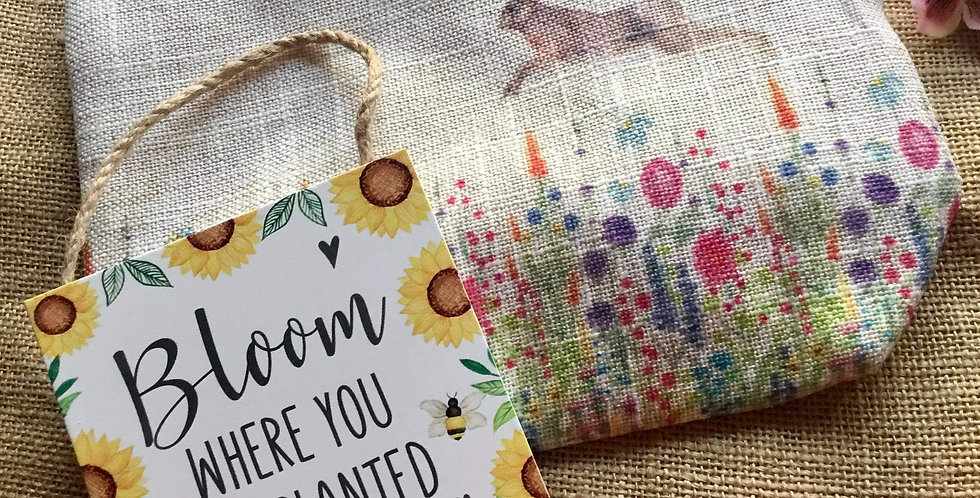 Leaping Hare Linen Cosmetic Bag and a Bloom Where You Are Planted Sign