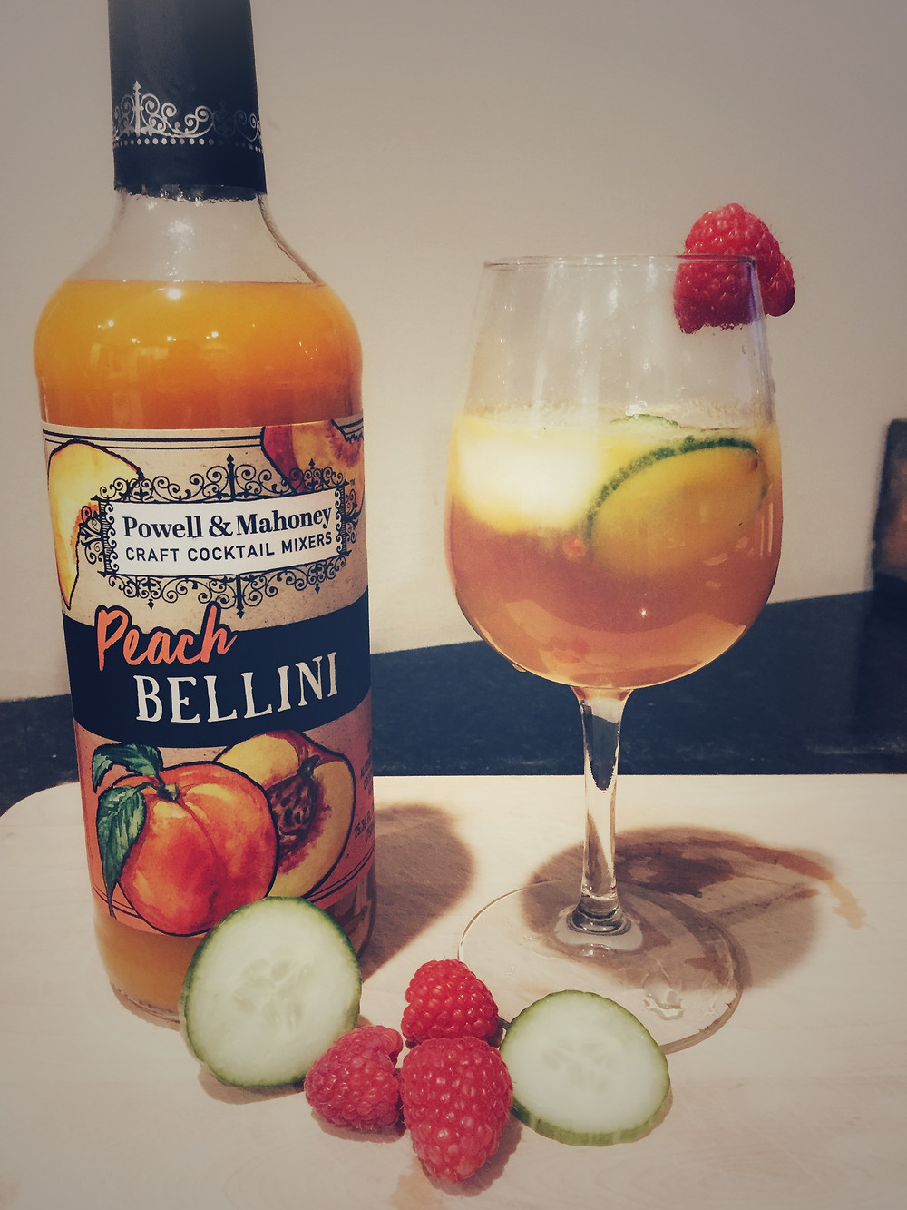 Peach Bellini mixer, raspberries, cucumbers and ginger combine in a delicious mocktail.