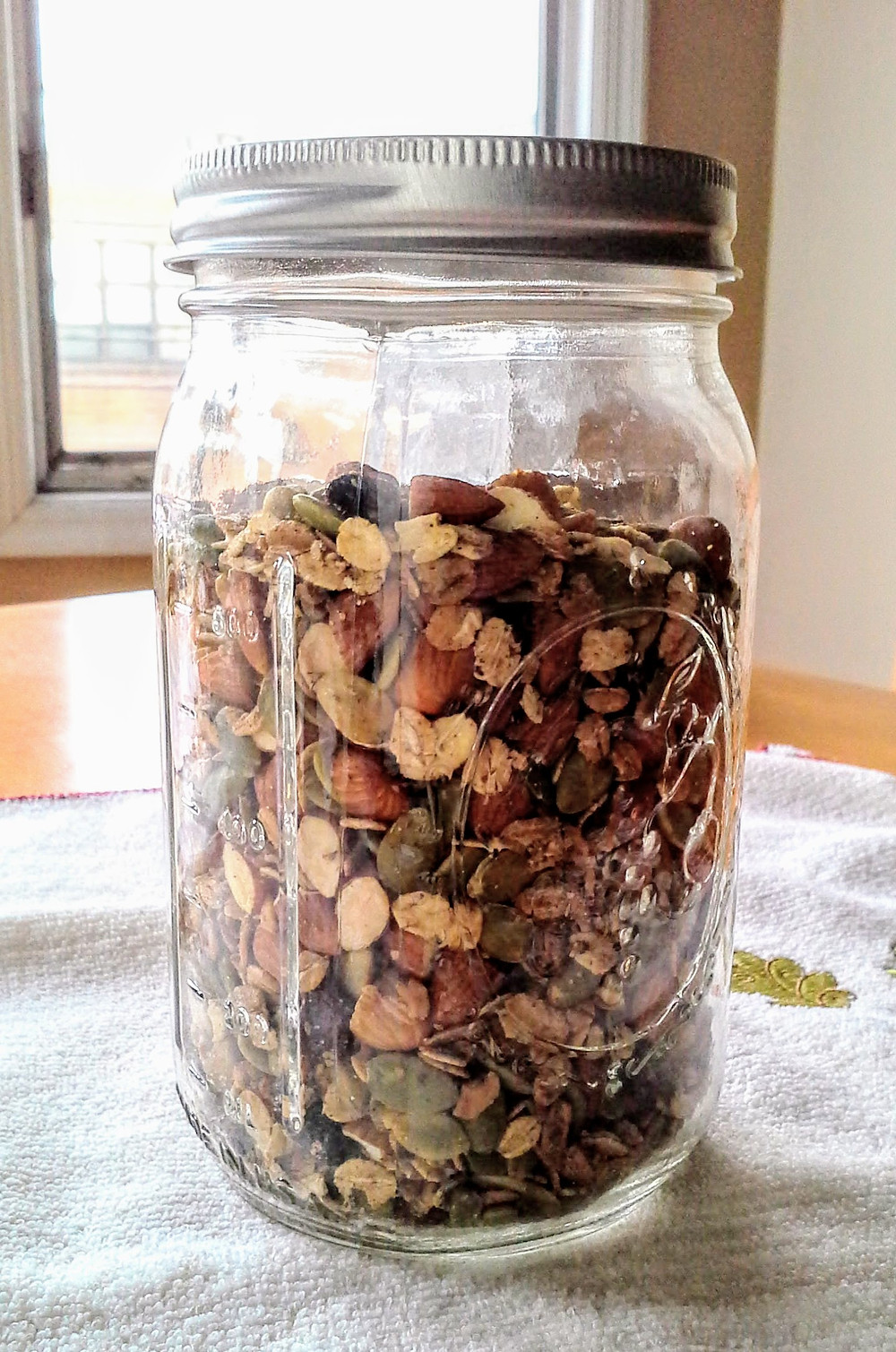 Baked granola in a Mason jar