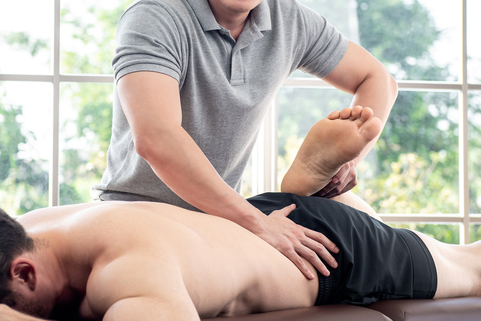 Physical therapist giving massage and st