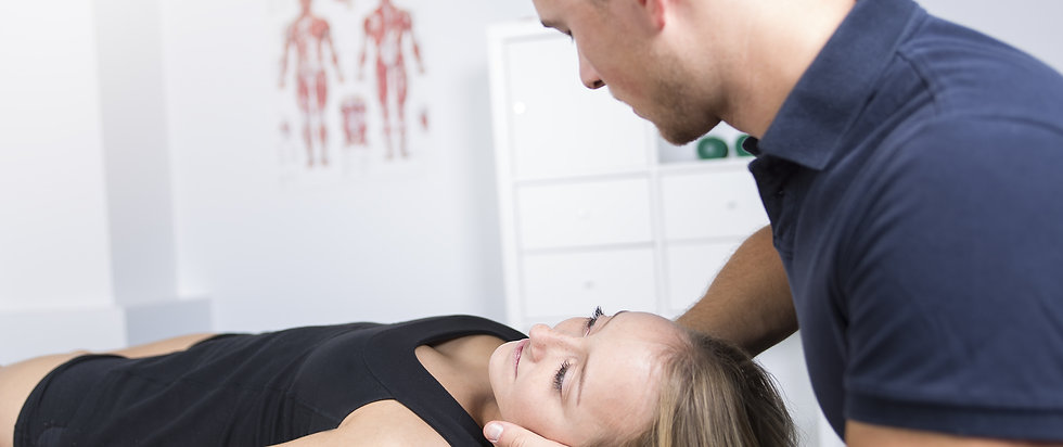 A male physio therapist and woman helpin