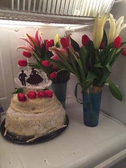 the stage cake and wedding flowers