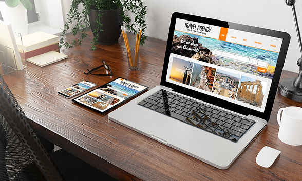 devices-travel-agency-on-wooden-desktop.