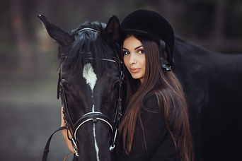 woman-and-horse-in-riding-school.jpg