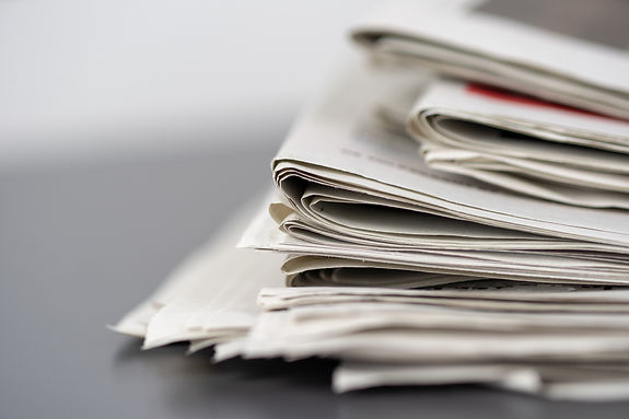 closeup-shot-of-several-newspapers-stack