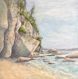 A rocky cliff lies at the breaker's edge