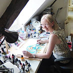 Lynn at her studio table.jpg