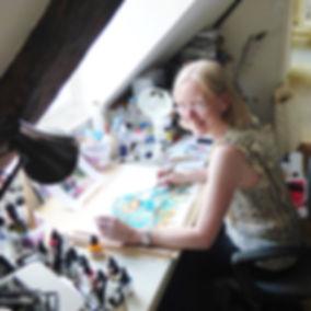 Lynn at her studio table.jpg