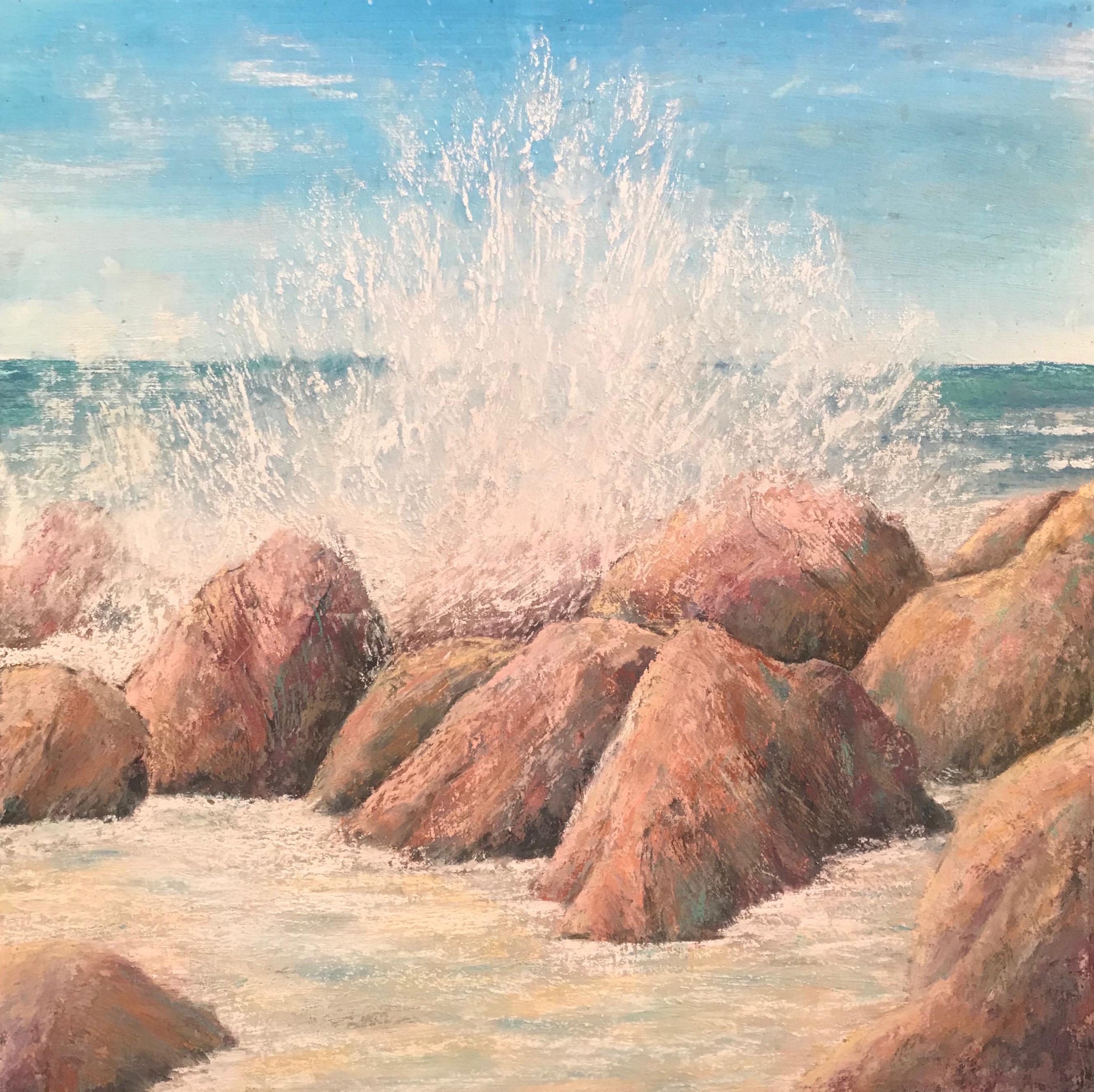 Waves crash upon the stolid rock