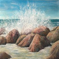 Waves crash on the stolid rocks