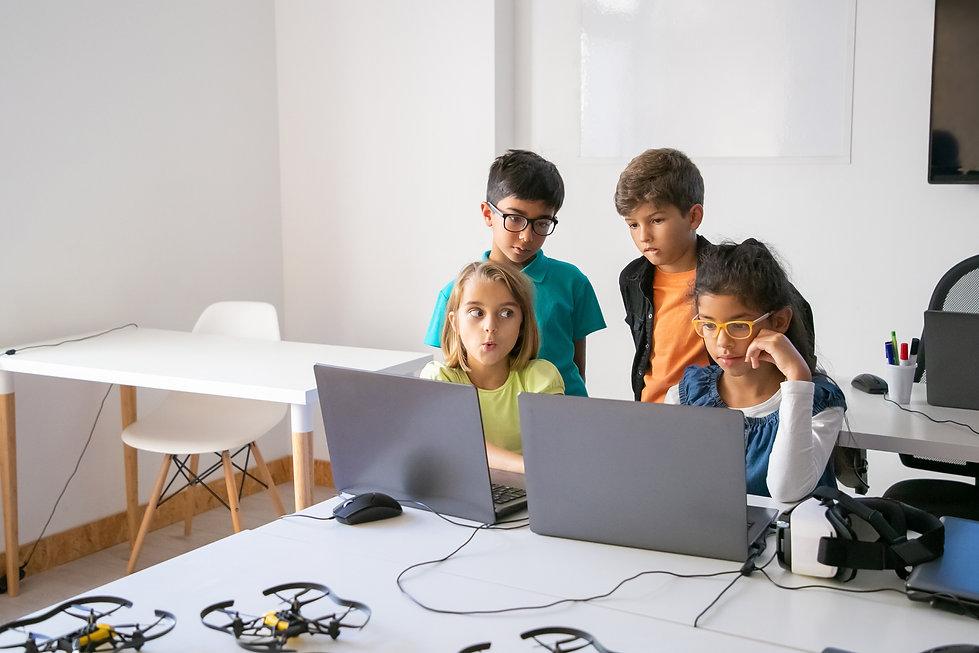 little-classmates-doing-group-task-using