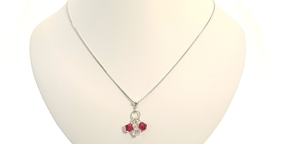 Ruby Red Swarovski Crystals Pendand and Chain on Display Bust