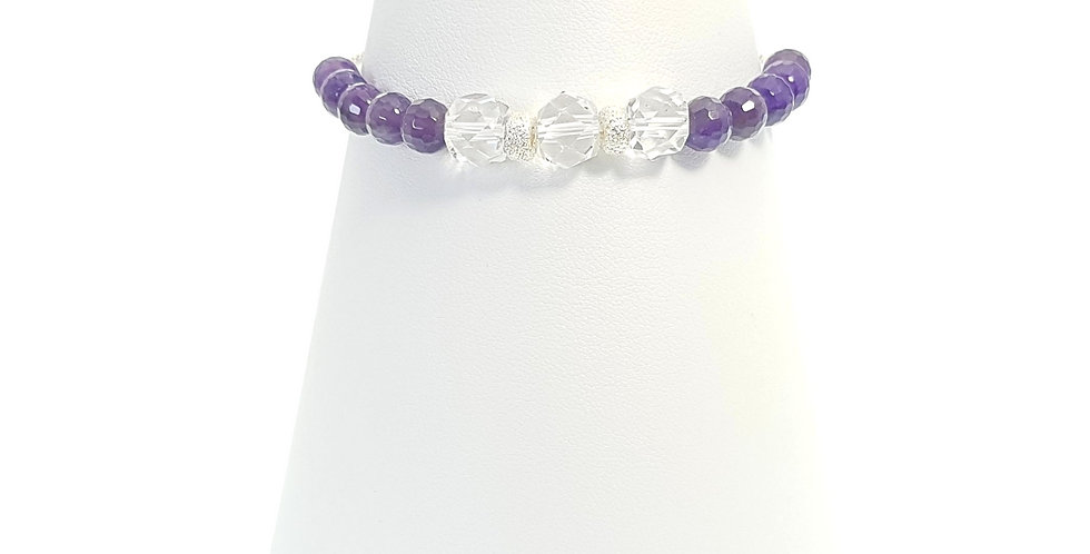 amethyst, clear quartz and sterling silver adjustable bracelet on stand