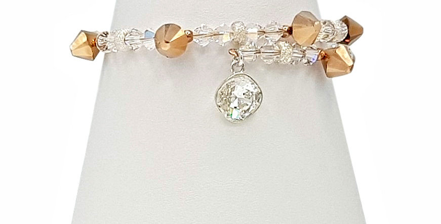 rose gold metallic Swarovski crystal bracelet with charm front view