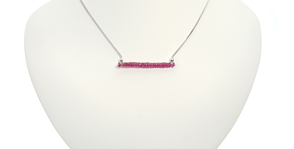 pink sapphire and sterling silver bar necklace on display bust