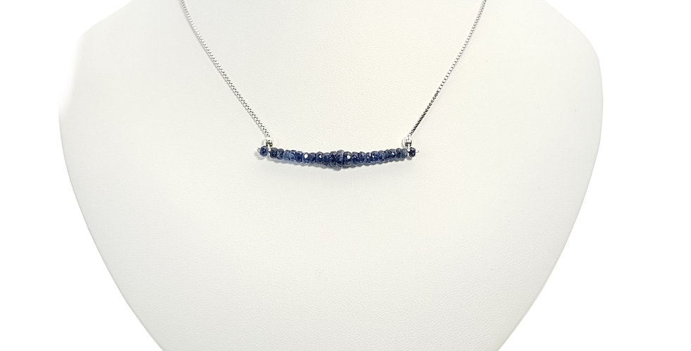 blue sapphire and sterling silver bar necklace on display bust