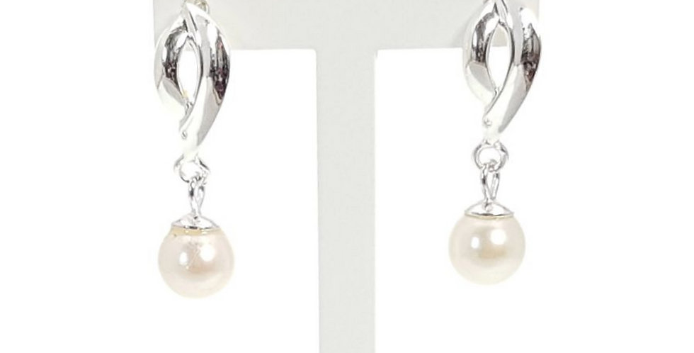 pearls and sterling silver earrings on display stand
