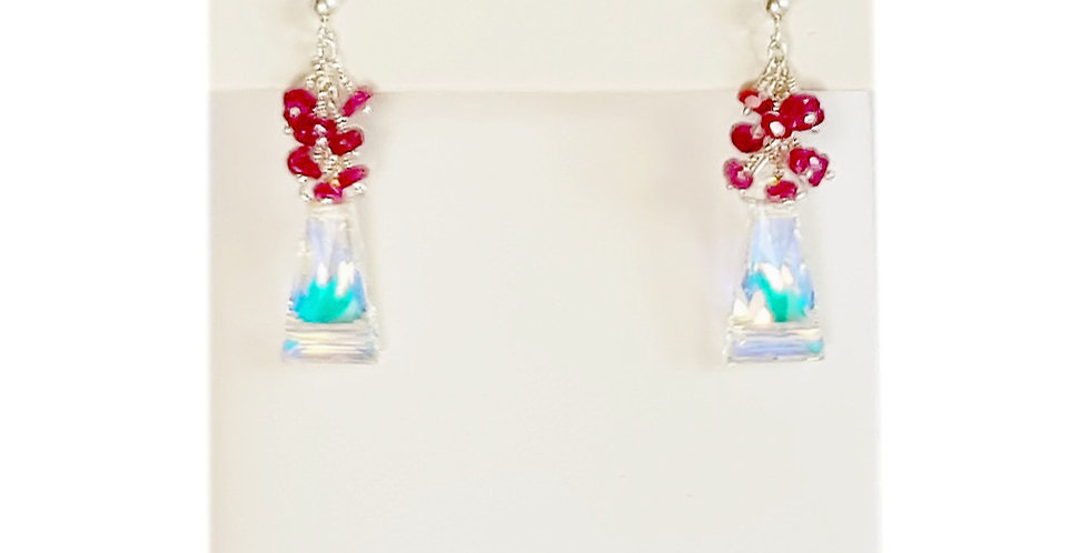 pink sapphire and Swarovski crystal sterling silver post style earrings on earring display
