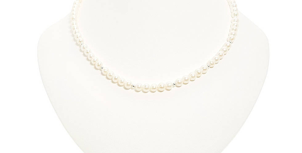 pearls and sterling silver necklace on stand