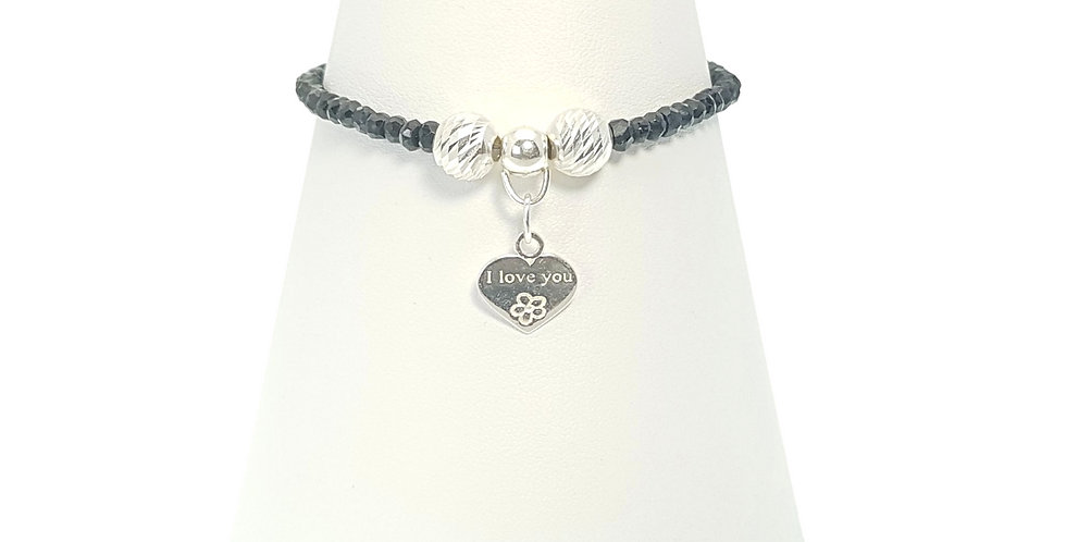 Black Spinel and Sterling Silver I Love You Bracelet on display stand