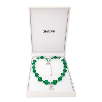 """Green onyx and sterling silver necklace in a white gift box. Logo reads """"Bonnie Gems Jewellery""""."""