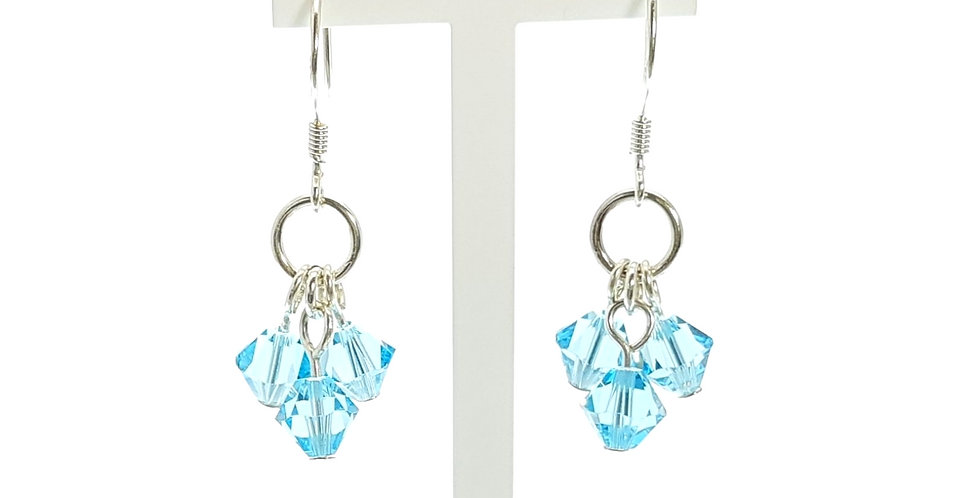 blue sterling silver earrings on stand